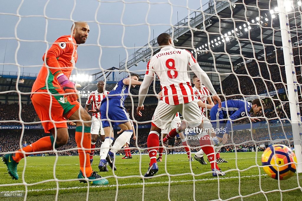 Chelsea's English defender Gary Cahill (3rd L) turns to celebrate after scoring the opening goal of the English Premier League football match between Chelsea and Stoke City at Stamford Bridge in London on December 31, 2016. / AFP / Adrian DENNIS / RESTRICTED TO EDITORIAL USE. No use with unauthorized audio, video, data, fixture lists, club/league logos or 'live' services. Online in-match use limited to 75 images, no video emulation. No use in betting, games or single club/league/player publications. /