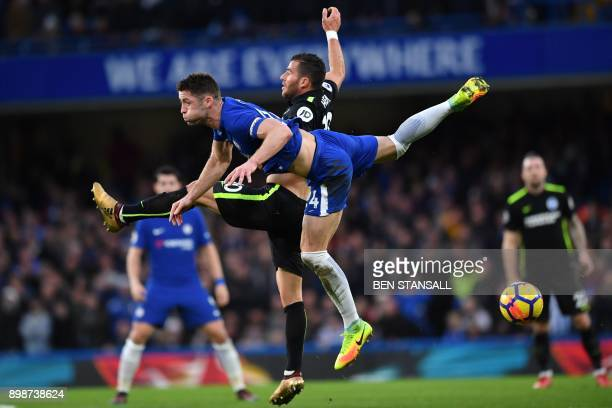Chelsea's English defender Gary Cahill vies with Brighton's Israeli striker Tomer Hemed during the English Premier League football match between...