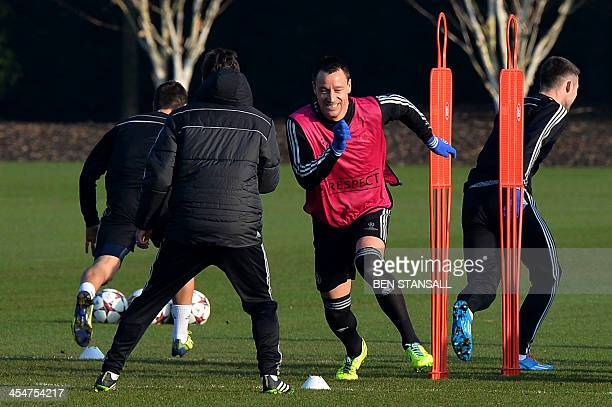 Chelsea's English defender John Terry attends a training session at the club's training ground in Cobham Surrey south of London on December 10 2013...