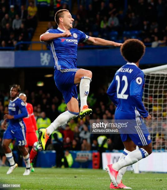 Chelsea's English defender John Terry celebrates scoring the opening goal during the English Premier League football match between Chelsea and...
