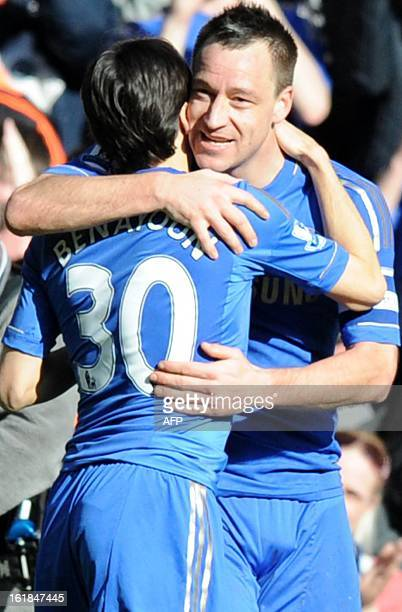 Chelsea's English defender John Terry celebrates with Israeli teammate Yossi Benayoun after scoring a goal during the fourth round replay English FA...