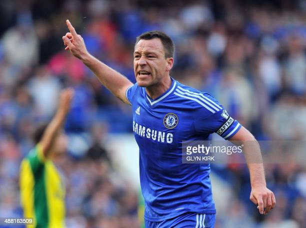 Chelsea's English defender John Terry complains to the linesman after having a foul given against him during the English Premier League football...