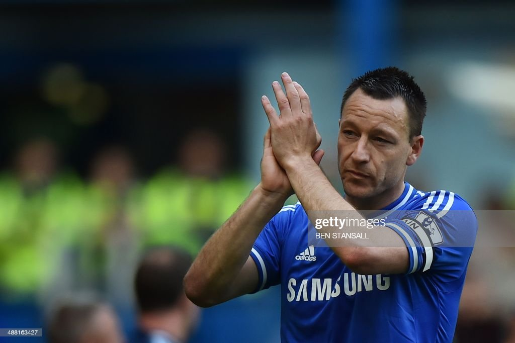 Chelsea's English defender John Terry gestures to fans during a lap of honour at the end of the English Premier League football match between Chelsea and Norwich City at Stamford Bridge in London on May 4, 2014. Chelsea missed the chance to go top of the Premier League after being held to a goalless draw at home to strugglers Norwich. USE. No use with unauthorized audio, video, data, fixture lists, club/league logos or live services. Online in-match use limited to 45 images, no video emulation. No use in betting, games or single club/league/player publications. / AFP PHOTO / Ben STANSALL