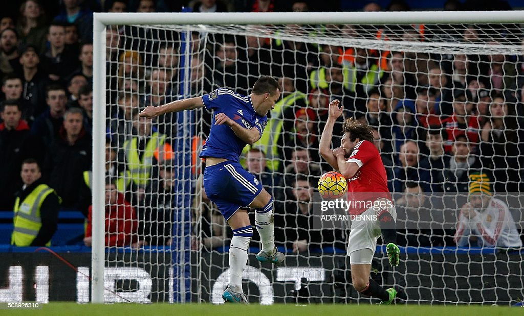 Chelsea's English defender John Terry (L) has a shot on goal blocked by Manchester United's Dutch midfielder Daley Blind during the English Premier League football match between Chelsea and Manchester United at Stamford Bridge in London on February 7, 2016. / AFP / ADRIAN DENNIS / RESTRICTED TO EDITORIAL USE. No use with unauthorized audio, video, data, fixture lists, club/league logos or 'live' services. Online in-match use limited to 75 images, no video emulation. No use in betting, games or single club/league/player publications. /