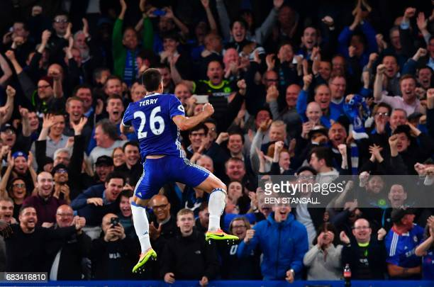 TOPSHOT Chelsea's English defender John Terry jumps in celebration after scoring the opening goal during the English Premier League football match...