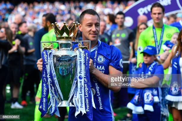 Chelsea's English defender John Terry poses with the English Premier League trophy, as players celebrate their league title win at the end of the...