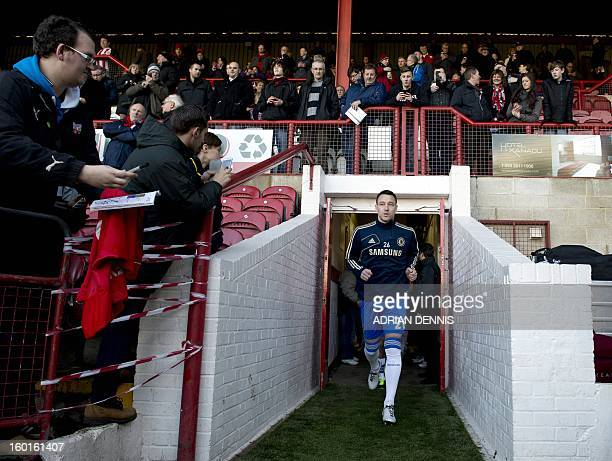 Chelsea's English defender John Terry runs out of the tunnel ahead of the game against Brentford during the FA Cup fourth round football match...