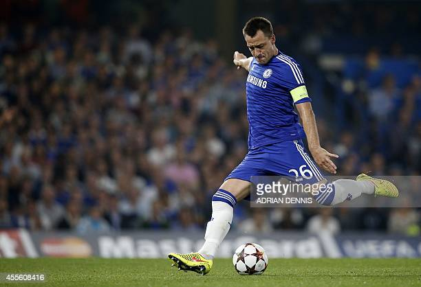 Chelsea's English defender John Terry takes a shot at goal after Referee Ivan Bebek whistled for a foul during the UEFA Champions League group G...