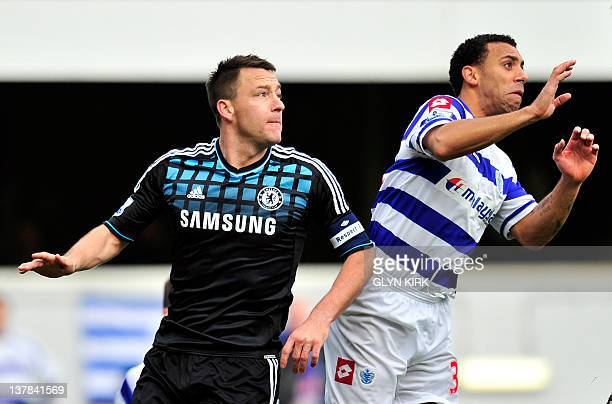 Chelsea's English defender John Terry vies with Queens Park Rangers' English defender Anton Ferdinand during the English FA Cup fourth round football...