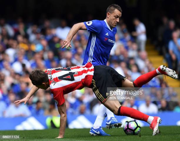 Chelsea's English defender John Terry vies with Sunderland's Belgian midfielder Adnan Januzaj during the English Premier League football match...