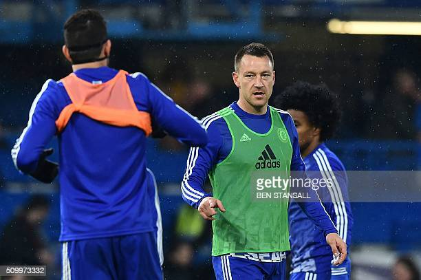 Chelsea's English defender John Terry warms up ahead of the English Premier League football match between Chelsea and Newcastle United at Stamford...
