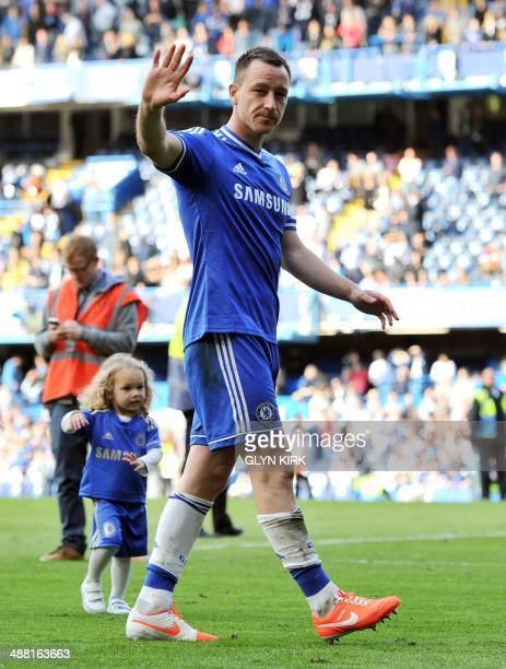 Chelsea's English defender John Terry waves to the fans after the English Premier League football match between Chelsea and Norwich City at Stamford...