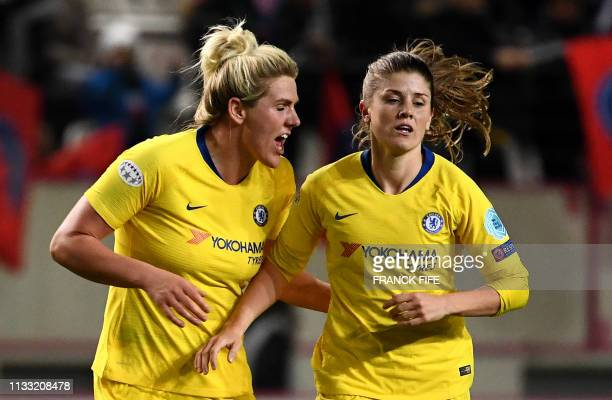 Chelsea's English defender Millie Bright congratulates English forward Francesca Kirby after she scored a goal during the UEFA Women's Champions...