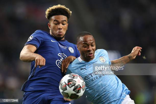 Chelsea's English defender Reece James fights for the ball with Manchester City's English forward Raheem Sterling during the UEFA Champions League...