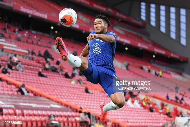 Chelsea's English defender Reece James lunges for the ball during the English Premier League football match between Liverpool and Chelsea at Anfield...