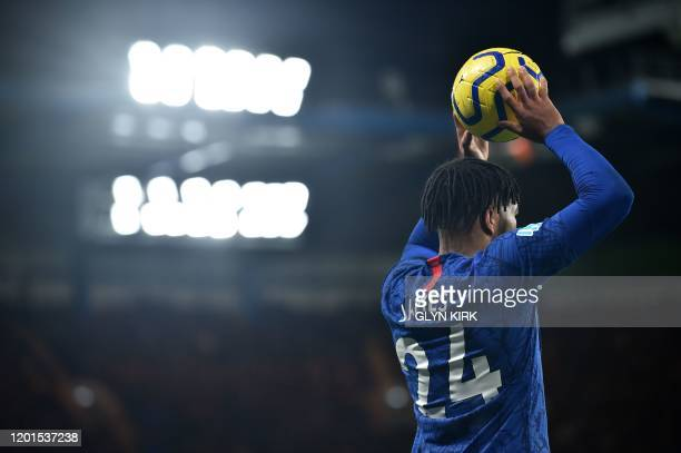 Chelsea's English defender Reece James takes a throwin during the English Premier League football match between Chelsea and Manchester United at...