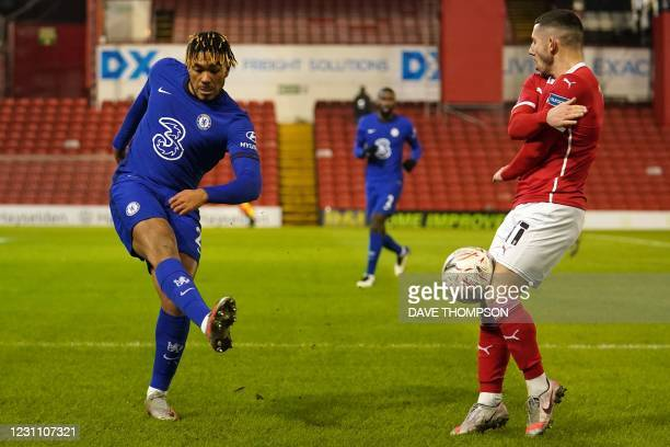 Chelsea's English defender Reece James vies with Barnsley's English striker Conor Chaplin during the English FA Cup fifth round football match...