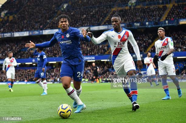 Chelsea's English defender Reece James vies with Crystal Palace's Ivorian striker Wilfried Zaha during the English Premier League football match...