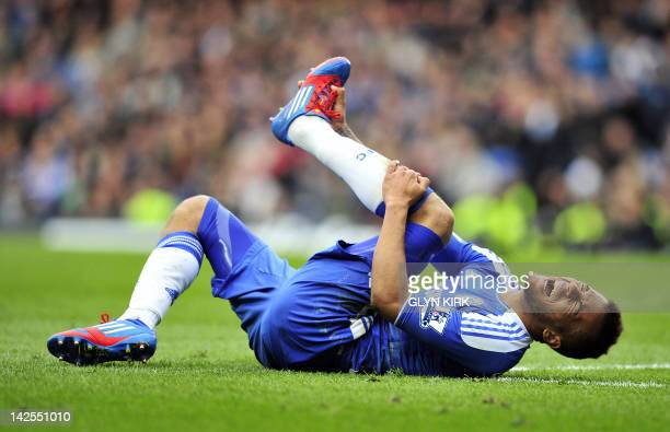 Chelsea's English defender Ryan Bertrand lies injured during the English Premier League football match between Chelsea and Wigan Athletic at Stamford...