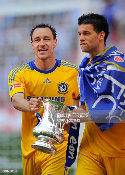 Chelsea's English footballer John Terry and German footballer Michael Ballack hold the FA Cup as they celebrate beating Everton 21 in the FA Cup...
