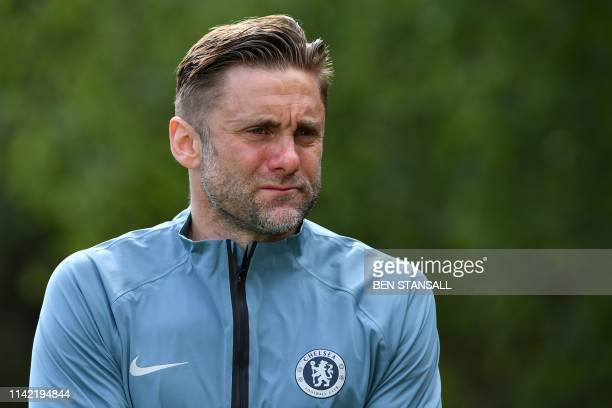 Chelsea's English goalkeeper Robert Green arrives to attend a training session at Chelsea's Cobham training facility in Stoke D'Abernon, southwest of...