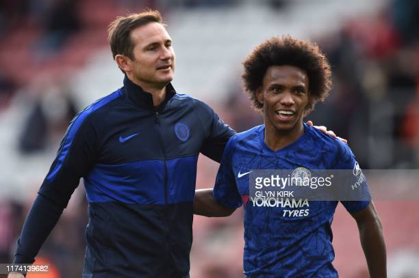 Chelsea's English head coach Frank Lampard and Chelsea's Brazilian midfielder Willian celebrate on the pitch after the English Premier League...