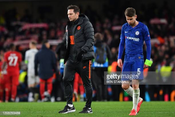 Chelsea's English head coach Frank Lampard and Chelsea's Italian midfielder Jorginho react to their defeat on the pitch after the UEFA Champion's...