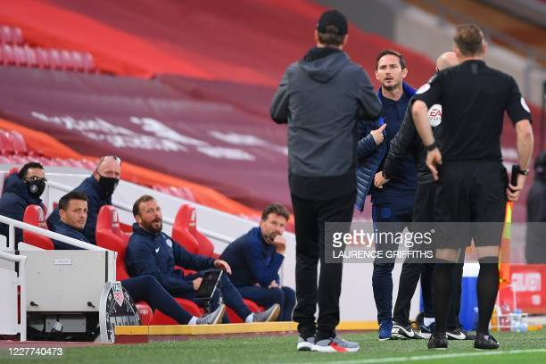 Chelsea's English head coach Frank Lampard and Liverpool's German manager Jurgen Klopp argue on the touchline during the English Premier League...
