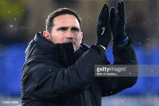 Chelsea's English head coach Frank Lampard applauds the fans following the UEFA Champions League Group E football match between Chelsea and FK...