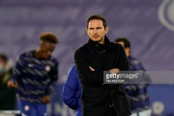 Chelsea's English head coach Frank Lampard looks on as Leicester City's players warm up during the English Premier League football match between...