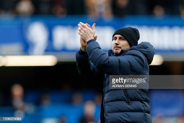 Chelsea's English head coach Frank Lampard salutes the fans after winning the English Premier League football match between Chelsea and Everton at...
