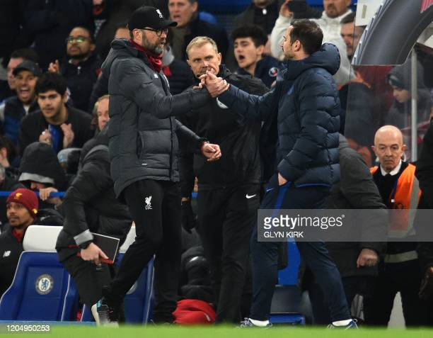 Chelsea's English head coach Frank Lampard shake hands with Liverpool's German manager Jurgen Klopp after winning the English FA Cup fifth round...