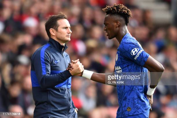 Chelsea's English head coach Frank Lampard shakes hands with Chelsea's English striker Tammy Abraham as he's substituted during the English Premier...