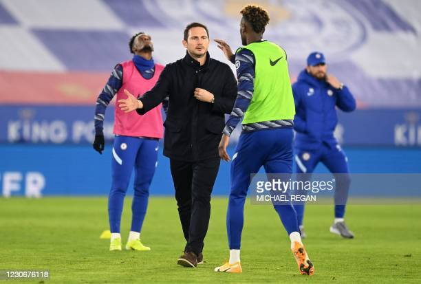 Chelsea's English head coach Frank Lampard taps hands with Chelsea's English striker Tammy Abraham during the warm up ahead of the English Premier...