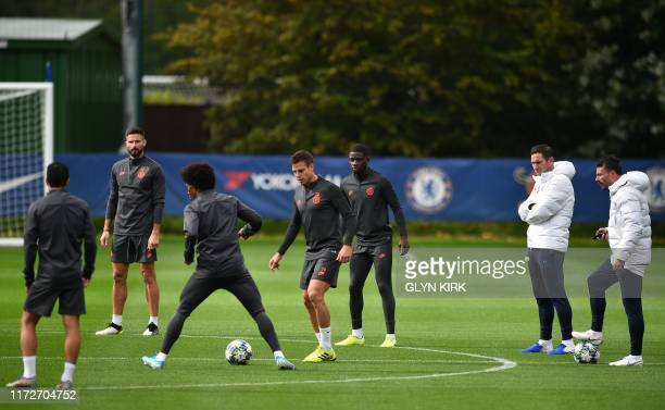 Chelsea's English head coach Frank Lampard watches his players including Chelsea's French striker Olivier Giroud Chelsea's Brazilian midfielder...