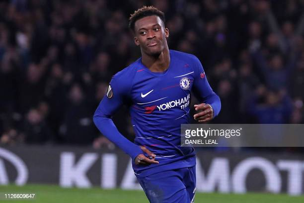 Chelsea's English midfielder Callum HudsonOdoi celebrates after scoring their third goal during the UEFA Europa League round of 32 2nd leg football...