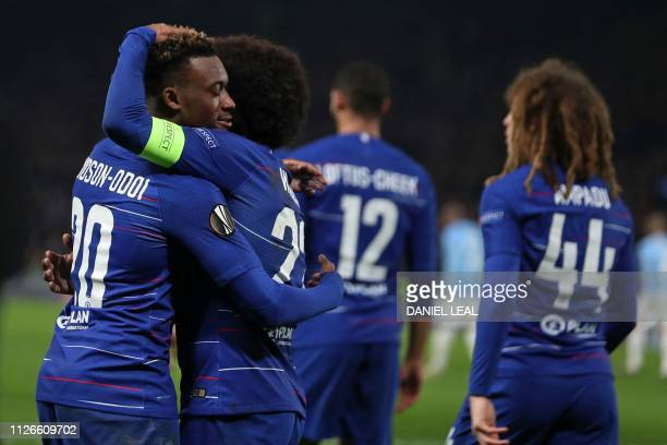 Chelsea's English midfielder Callum HudsonOdoi celebrates with teammates after scoring their third goal during the UEFA Europa League round of 32 2nd...