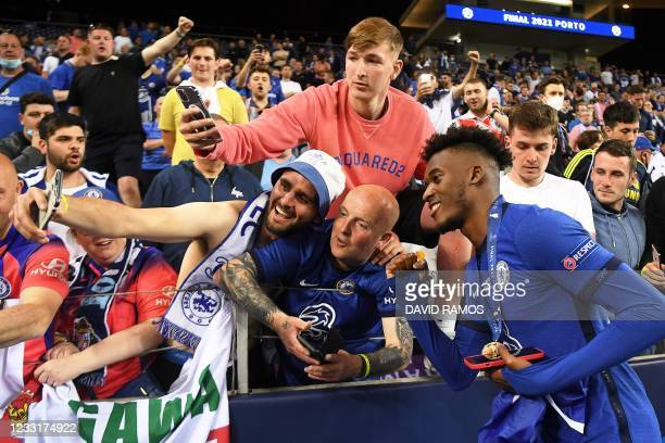 Chelsea's English midfielder Callum Hudson-Odoi poses for pictures with supporters after winning the UEFA Champions League final football match...