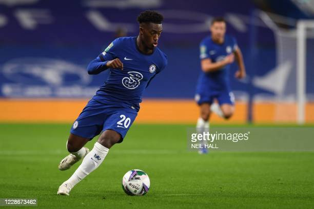 Chelsea's English midfielder Callum Hudson-Odoi runs with the ball during the English League Cup third round football match between Chelsea and...
