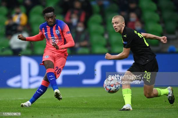 Chelsea's English midfielder Callum Hudson-Odoi shoots to score the opening goal during the UEFA Champions League football match between Krasnodar...