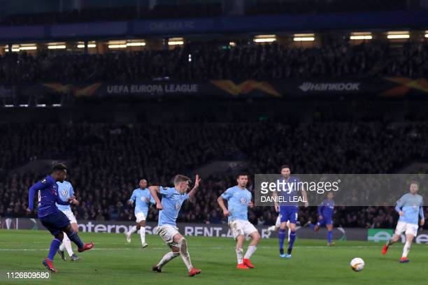 Chelsea's English midfielder Callum HudsonOdoi shoots to score their third goal during the UEFA Europa League round of 32 2nd leg football match...
