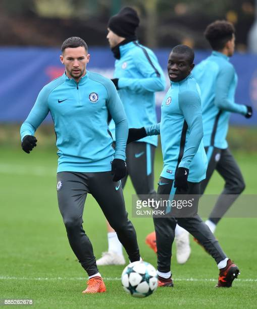 Chelsea's English midfielder Danny Drinkwater and Chelsea's French midfielder N'Golo Kante attend a training session at Chelsea's Cobham training...