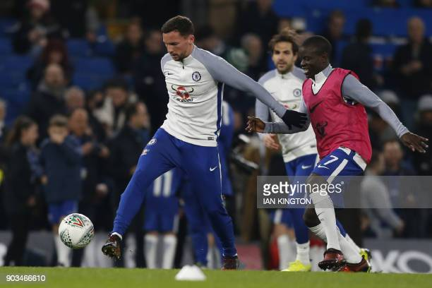 Chelsea's English midfielder Danny Drinkwater and Chelsea's French midfielder N'Golo Kante warm up ahead of the English League Cup semifinal first...