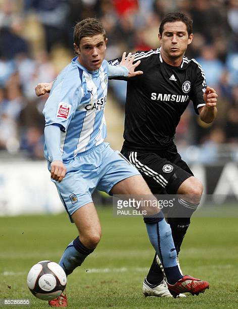 Chelsea's English midfielder Frank Lampard closes in on Coventry City's English midfielder Jordan Henderson during their English FA Cup sixth round...