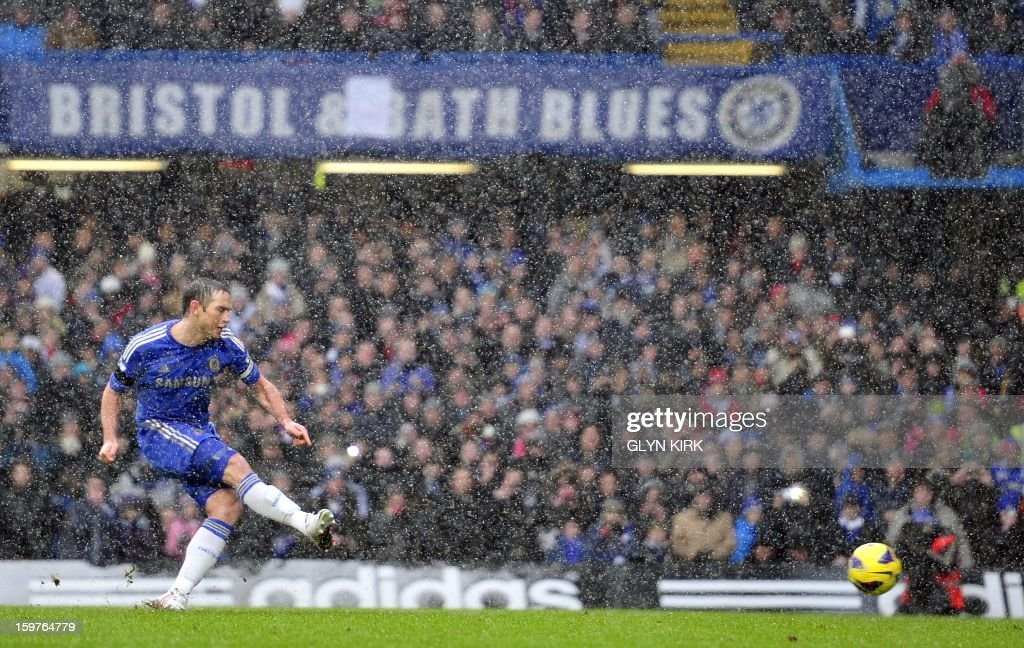 """Chelsea's English midfielder Frank Lampard scores their second goal during their English Premier League football match against Arsenal at Stamford Bridge in London, England on January 20, 2013. AFP PHOTO/Glyn KIRK - RESTRICTED TO EDITORIAL USE. No use with unauthorized audio, video, data, fixture lists, club/league logos or """"live"""" services. Online in-match use limited to 45 images, no video emulation. No use in betting, games or single club/league/player publications."""