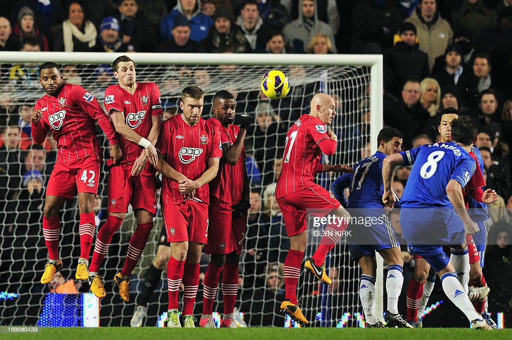 """Chelsea's English midfielder Frank Lampard (R) takes a freekick during the English Premier League football match between Chelsea and Southampton at Stamford Bridge in London, on January 16, 2013. The game finished 2-2. USE. No use with unauthorized audio, video, data, fixture lists, club/league logos or """"live"""" services. Online in-match use limited to 45 images, no video emulation. No use in betting, games or single club/league/player publications."""