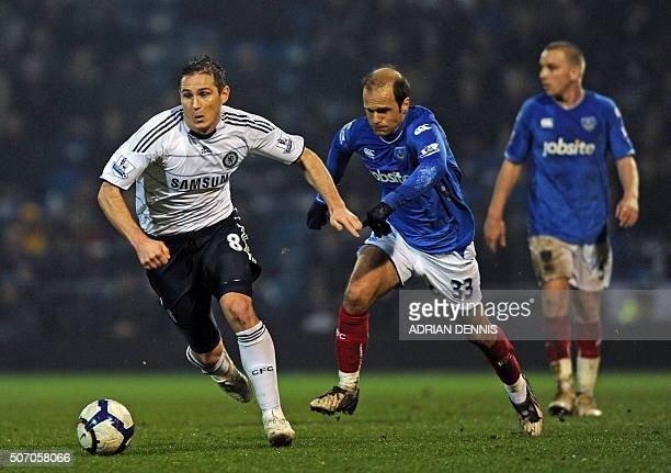 Chelsea's English midfielder Frank Lampard vies with Portsmouth's Greek player Angelos Basinas during the English Premier League football match...