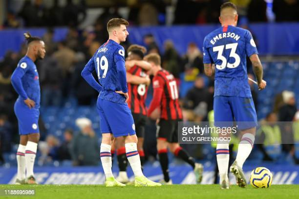 Chelsea's English midfielder Mason Mount and Chelsea's BrazilianItalian defender Emerson Palmieri react at the final whistle during the English...