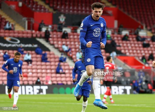 Chelsea's English midfielder Mason Mount celebrates after scoring their first goal from the penalty spot during the English Premier League football...