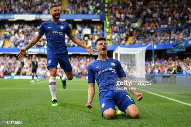 Chelsea's English midfielder Mason Mount celebrates scoring the opening goal with Chelsea's French striker Olivier Giroud during the English Premier...
